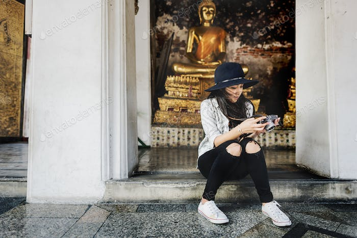 Woman Sitting Checking Photo Concept