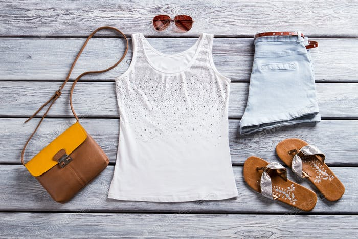 White tank top and sunglasses.