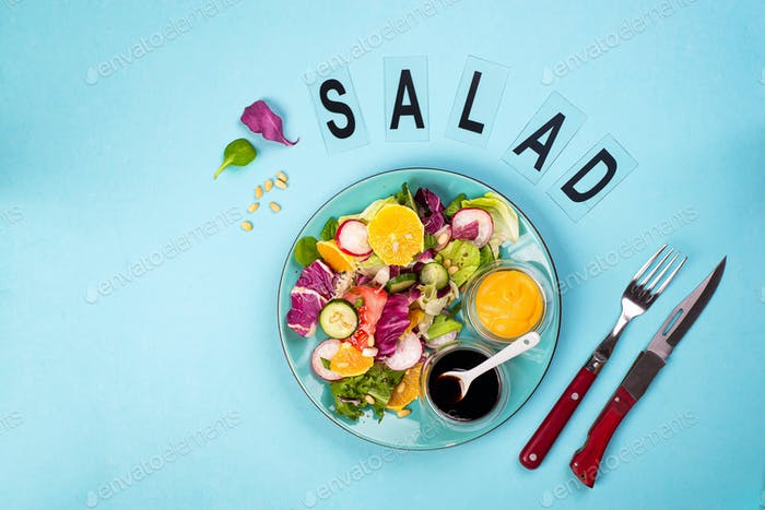 Fresh vegetable salad with red cabbage, cucumber, radish, carrots, sweet peppers,