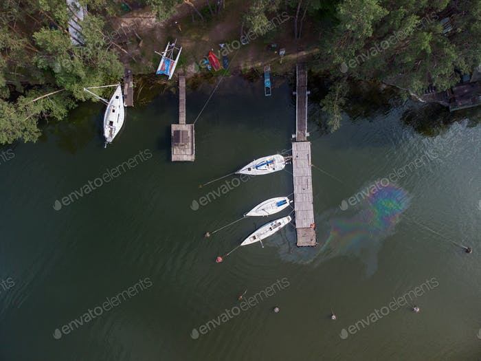 Aerial view of a water pollution. Oil stain on the water from the yacht. Environmental disaster.