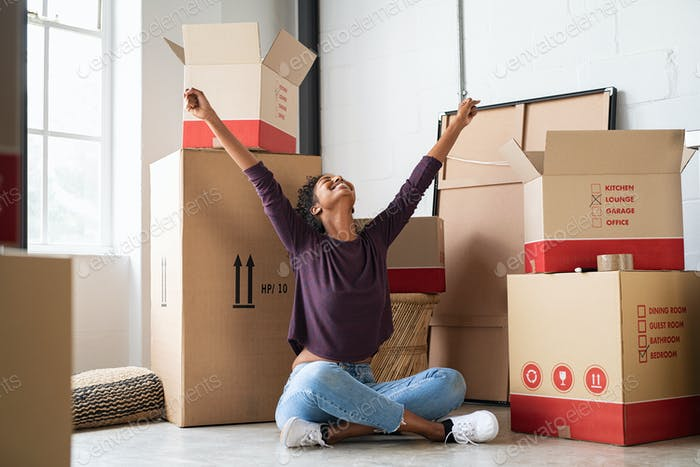 Excited young woman in new house
