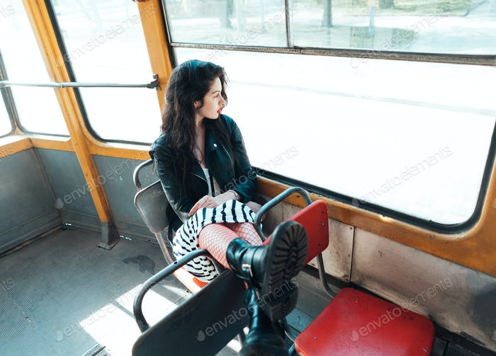 Woman traveling inside the tram