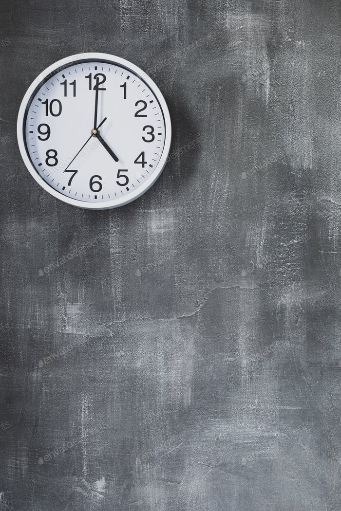 clock at wall background surface