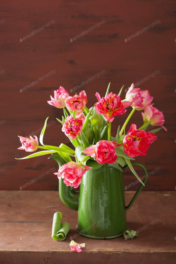 beautiful pink tulip flowers bouquet in green pot