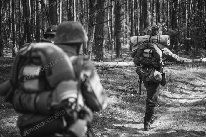 Re-enactors Dressed As German Infantry Soldiers In World War II