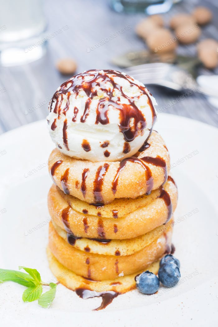 delicious dessert donuts with apples and ice cream