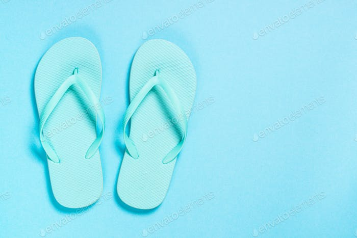 Blue flip flops on blue background