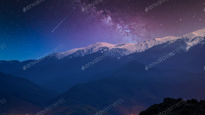 Night Scene With Pyrenees Mountains in France.Snow on Peaks.