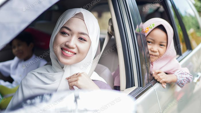 Muslim family in the car will go home to celebrate Eid