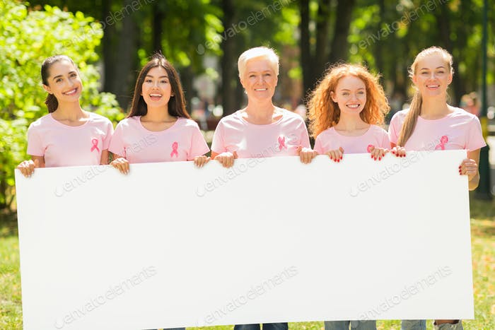 Breast Cancer Volunteers Holding Empty White Board For Text Outdoor