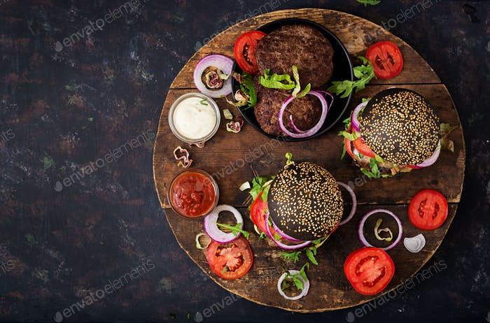 Black big sandwich -  black hamburger with juicy beef burger