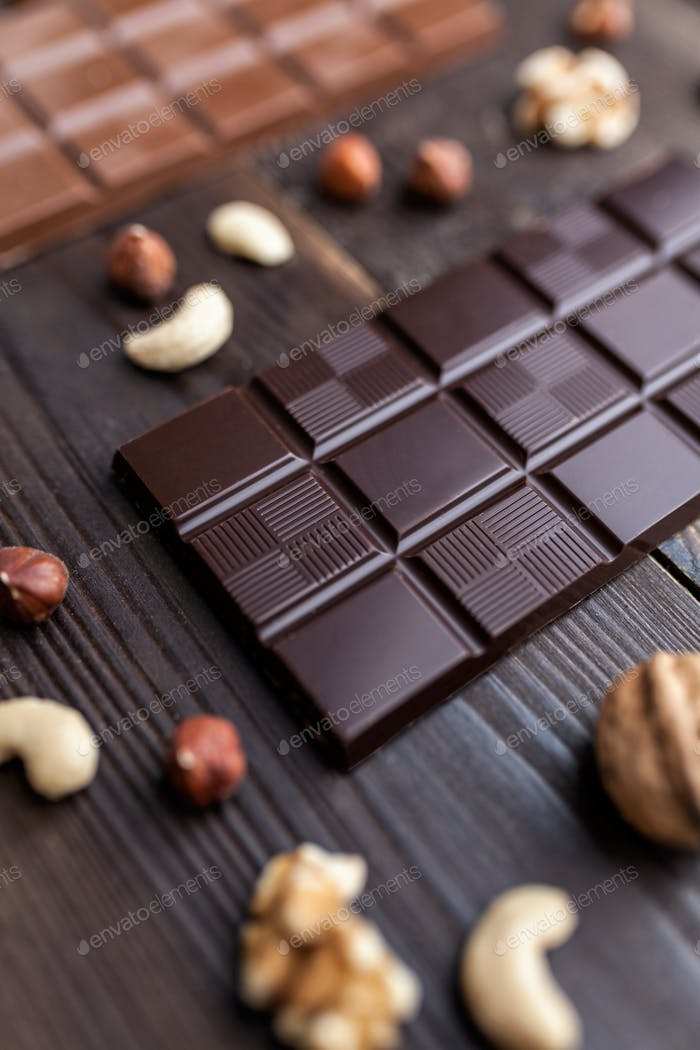 Delicious variety of chocolate on wooden background