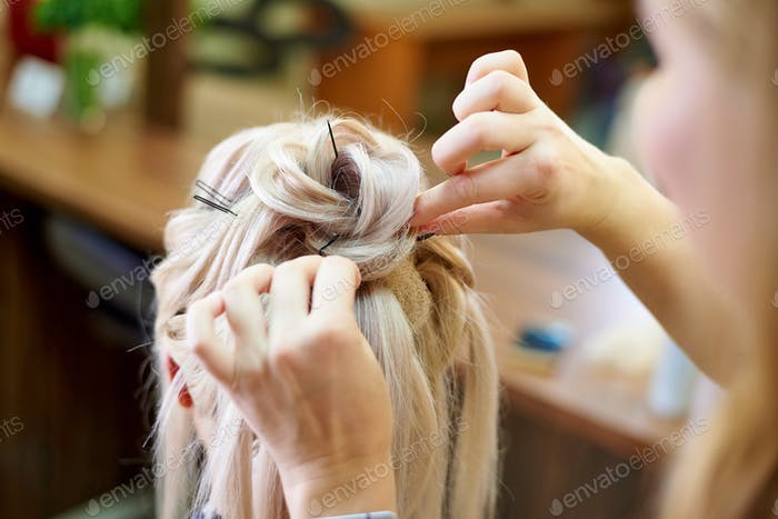Creation of an evening female hairstyle