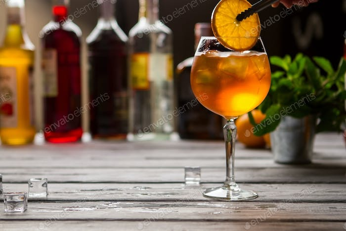 Wineglass with orange drink