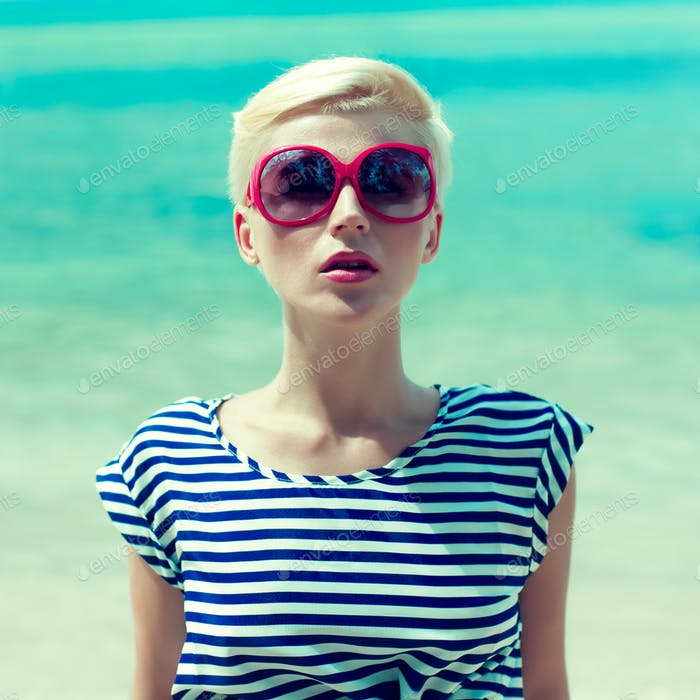 fashion portrait of a girl on a background of the sea
