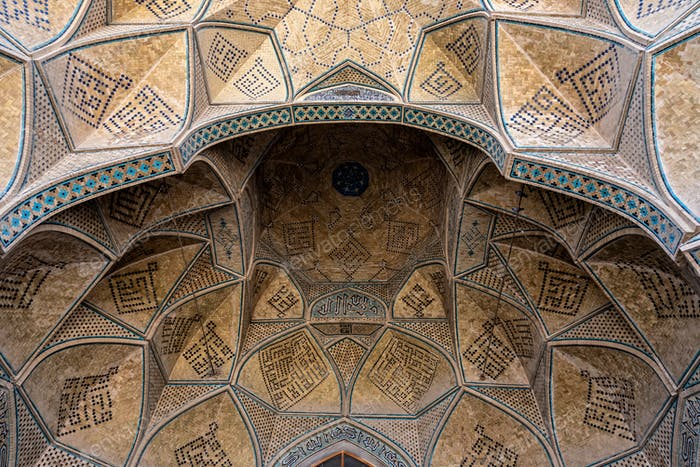 Detail of colored mosaic and textured ceiling at Shah Mosque in Isfahan, Iran