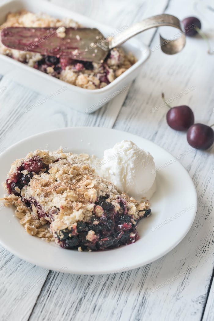 Portion of berry crumble with ice cream