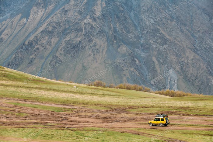 SUV Car On Off Road In Spring Mountains Landscape In Georgia. Dr