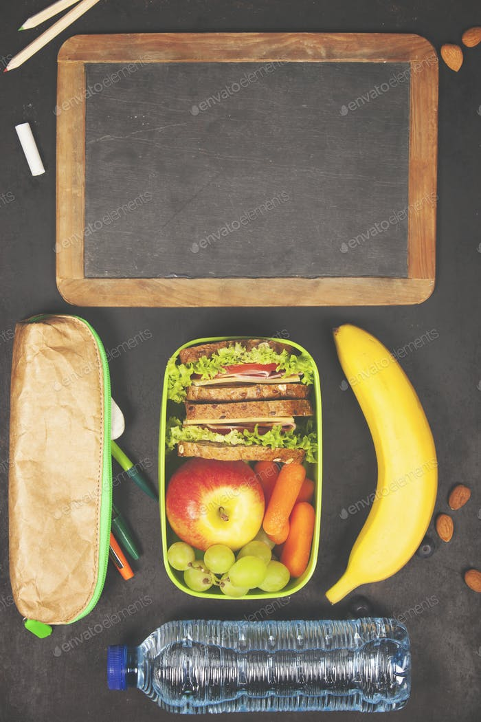 Sandwich, apple, grape, carrot, berry in plastic lunch boxes, st