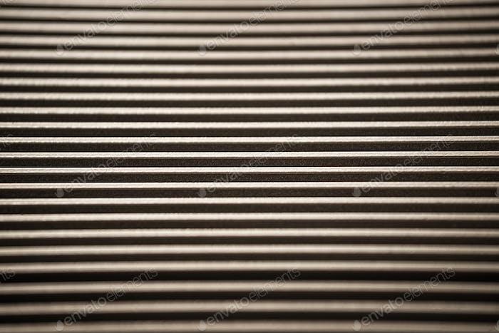 Nahaufnahme einer gewellten Metalloberfläche