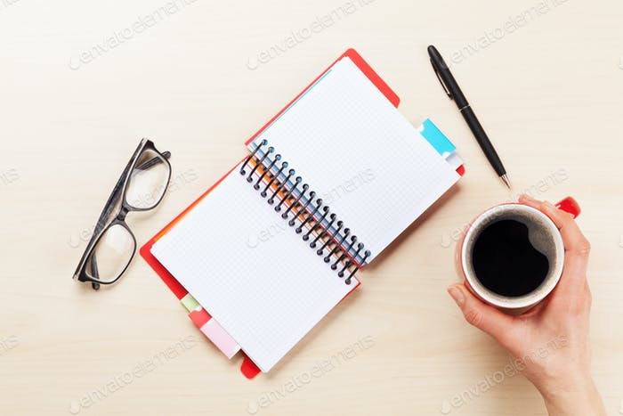 Woman working with pen and coffee
