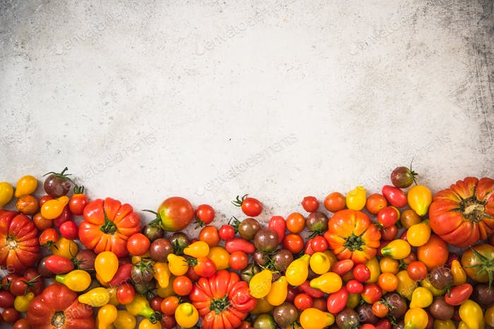 colorful selection of tomatoes on concrete stone slate