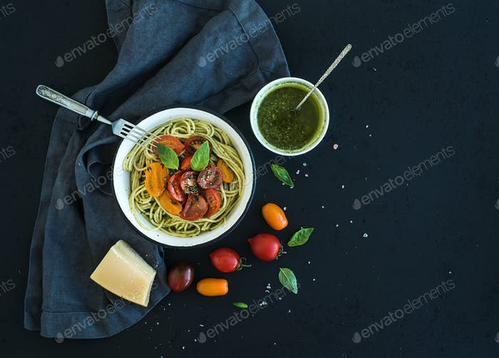 Pasta spaghetti with pesto sauce, basil, slow-roasted cherry-tomatoes