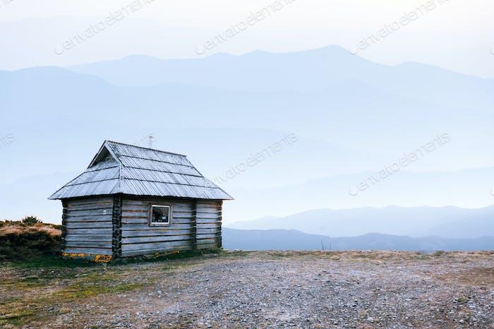 Mountain cabin during sunrise.
