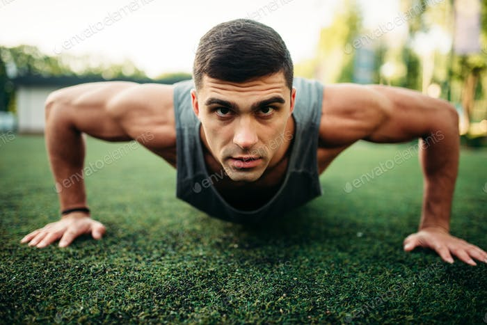 Male athlete doing push-up exercise outdoor