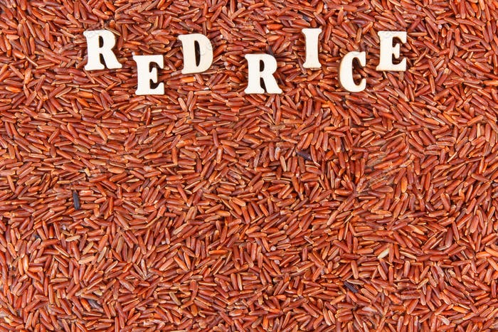 Heap of red rice, healthy, gluten free nutrition concept, copy space for text