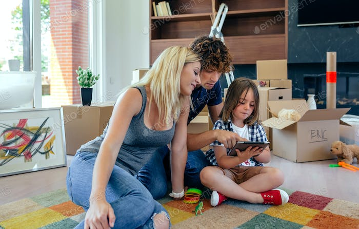 Parents and son playing the tablet