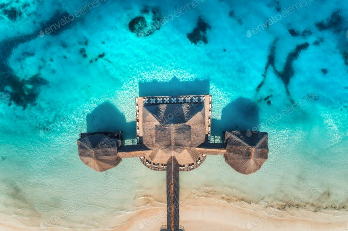 Aerial view of beautiful hotel in Indian ocean at sunrise