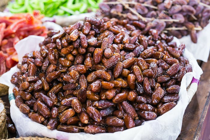 Fresh dates in a market - healthy lifestyle, food and fruit concept