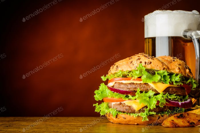 Burger and Mug of Cold Beer with Copy Space