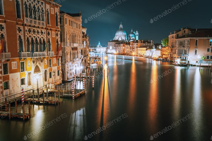 Venice, Italy. Grand Canal at night. Illumination light reflected on water surface. Majestic