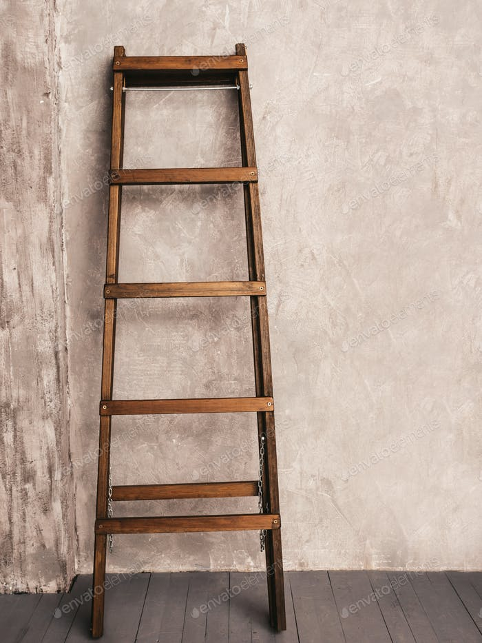 Wooden Ladder near gray