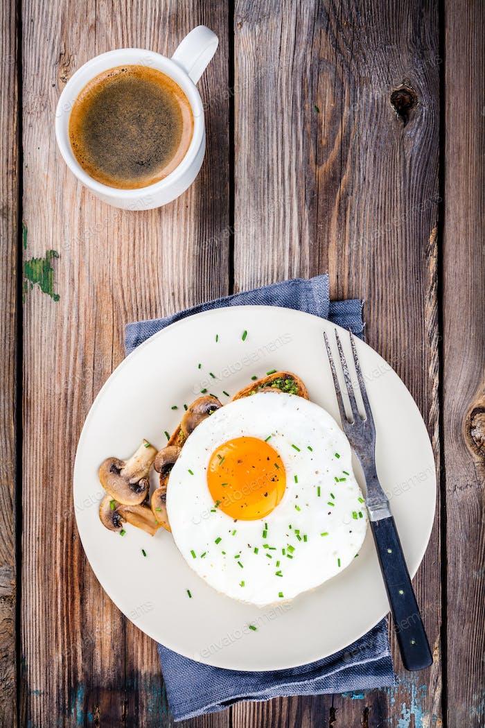 Breakfast: fried egg with mushrooms on toast