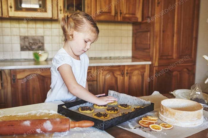 Mom and daughter are busy baking cookies