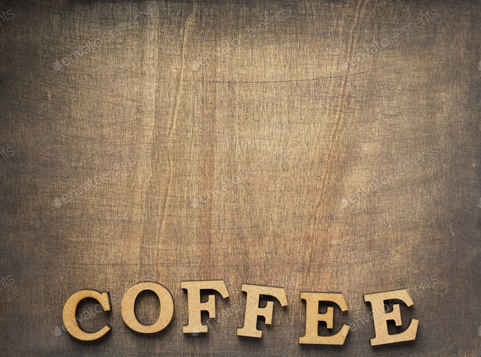 coffee letters at old wooden background
