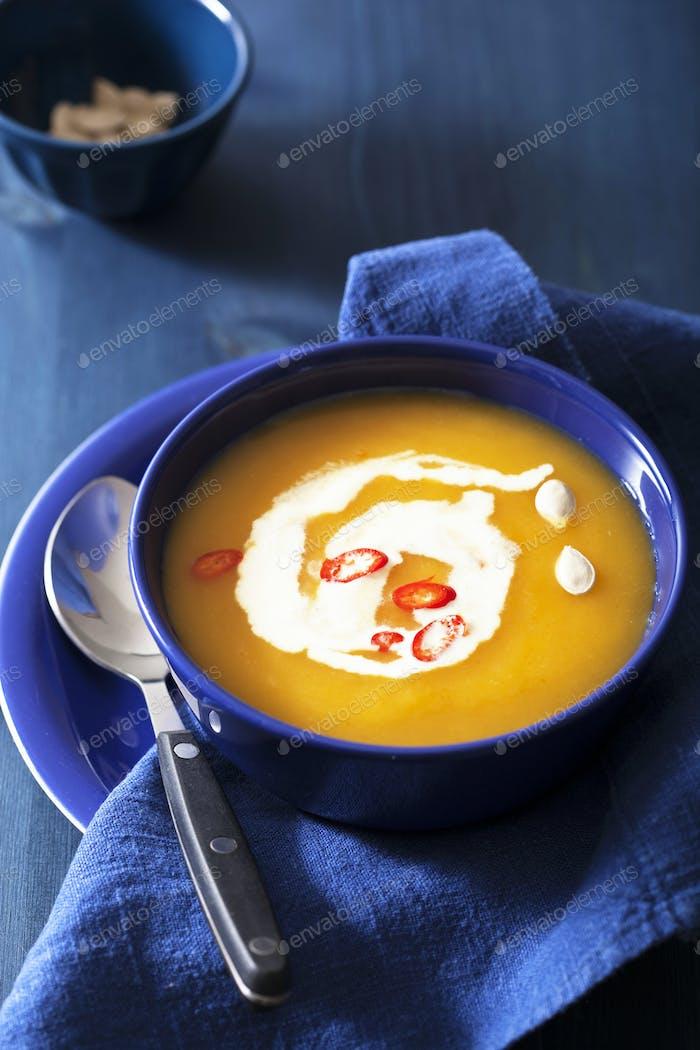 pumpkin soup in blue bowl