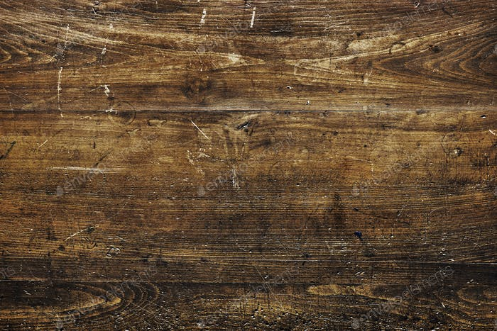 Scratched grunge wooden textured background
