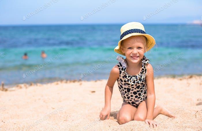 Adorable little girl have fun at tropical beach