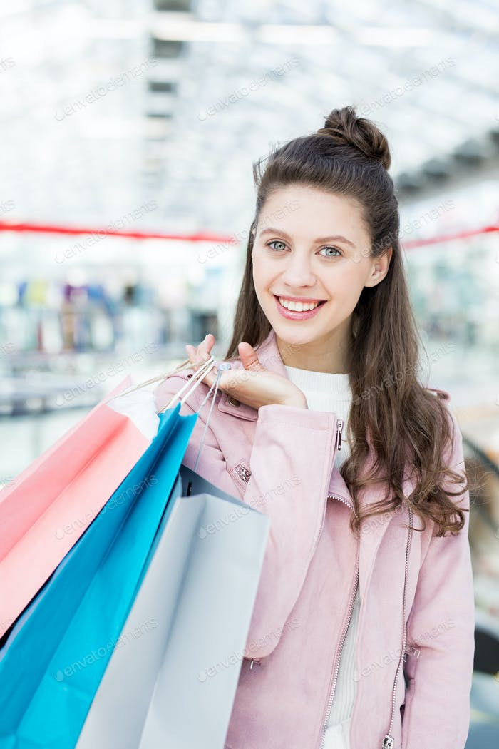 Cheerful teenager enjoying shopping