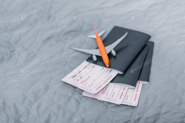 composition of flight tickets with toy airplane