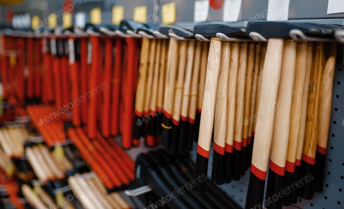 Hammers on racks closeup, tool store, nobody