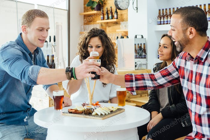 Four people tasting craft beer