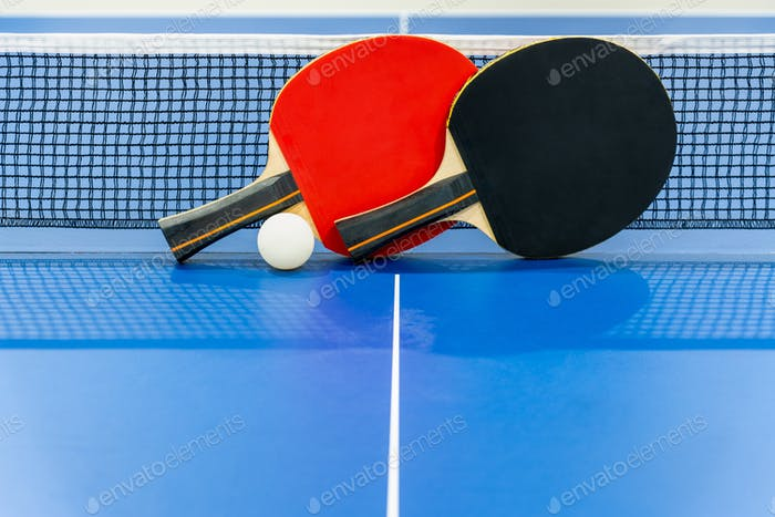 Black and red table tennis paddle with a net
