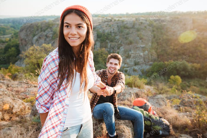 Young traveler couple in the mountains