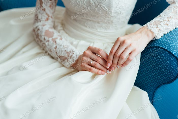 dress up the bride in a wedding dress with corset and lacing