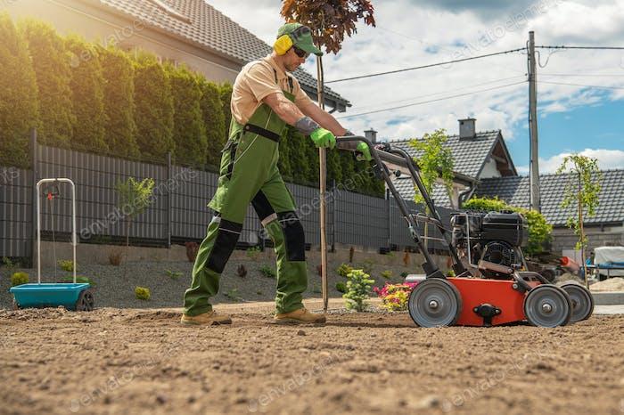 Gardener with Gasoline Engine Aerator